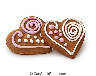 Heart shape ginger breads decorated with pink and white...