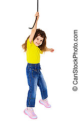 Cheerful little girl hanging on a rope