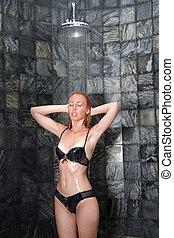 Girl under shower