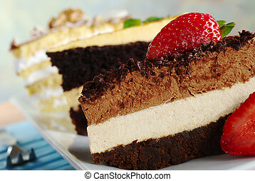 Layer cakes on a long plate: Chocolate Mousse Cake, Lucuma...
