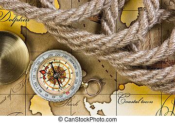 compass and rope on map - compass and rope on a map