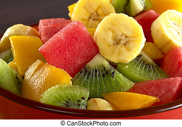 Exotic fruit salad of kiwi, banana, mango and watermelon...