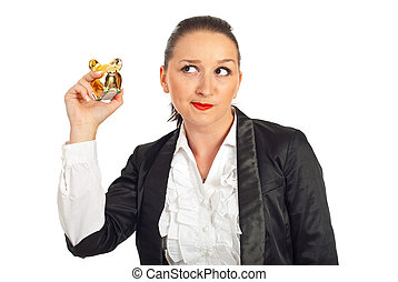 Woman trying to hear the sound of coins - Business woman...