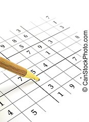 sudoku game - closeup of an unfinished sudoku puzzle with...