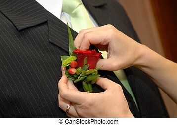 groom's flower - Wedding boutonniere placed on jacket of...