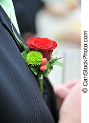 groom flower - Wedding boutonniere being on jacket of groom