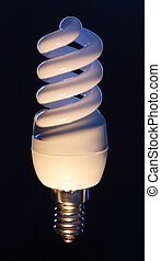 Energy efficient light bulb isolated on black