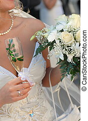 bride wearing wedding dress and  holding bouquet