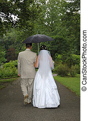 just married twosome  with umbrella