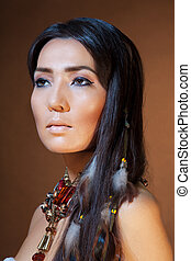 Close-up portrait of American Indian girl with professional...