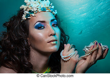 Treasures of underwater world - beauty shoot of a woman with...