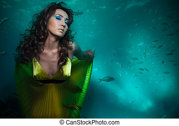 Queen of the sea - Beauty shoot of woman mermaid in yellow...