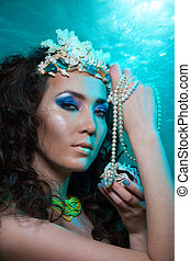 Underwater treasures - Beauty shoot of a woman with crown...