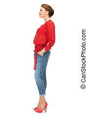 lovely woman in red blouse and jeans - bright picture of...