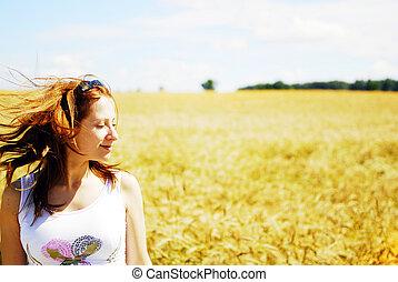 girl relaxing in fields