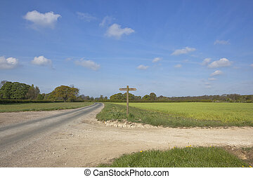 country crossroads - an english landscape with a crossroads...