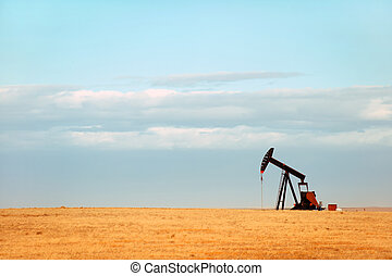 Great Plains - Working oil pump on Nebraska Great Plains