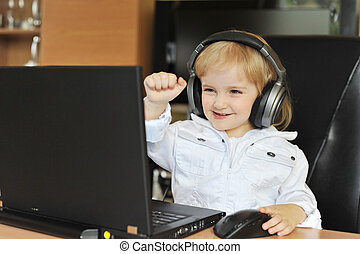 girl in ear-phones - Beautiful little girl in ear-phones...