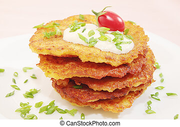 pancakes from the potatoes - fried pancakes from the...