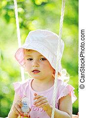 little girl  - Swinging little girl in park