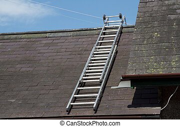Roof ladder - A roof ladder on a slate roof with ridge tiles...