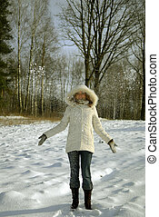 girl frowing snow sunny day