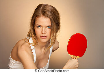 Ready to parry a blow - girl with red ping pong racket in...