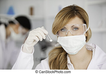 Attractive scientist woman looking at the camera in a lab