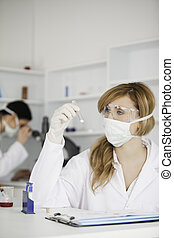 Scientists carrying out an experiment