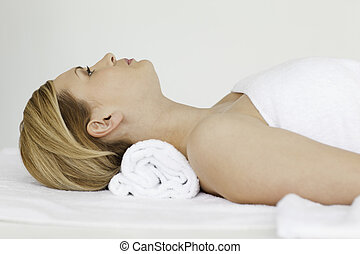 Cute blond-haired woman receiving a spa treatment