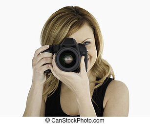 Blond-haired woman taking a photo with a camera on a white...