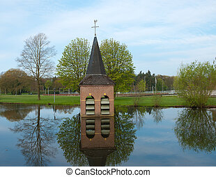 drowned church - church-tower just above the water surface...