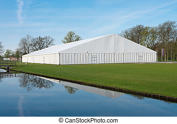 event tent - large white event tent on the campus area of...