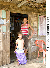 mother daughter native house Big Corn Island Nicaragua -...