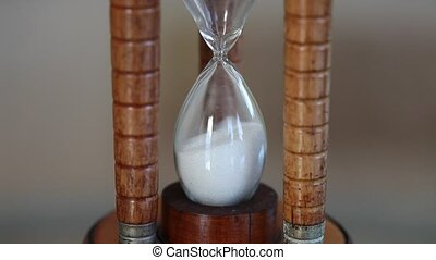 Starting time in an hourglass, hd - Sandglass turned upside...