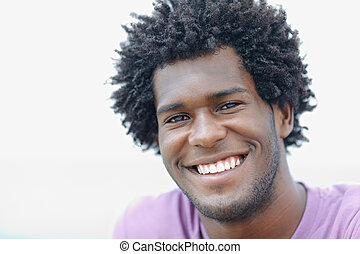 young african man smiling at camera