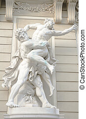 greek gods wrestling each other - antique statue of two...
