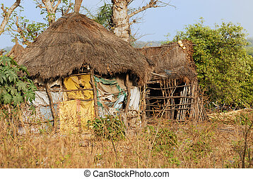 African hut - Cob cottage with thatched straw roof in...