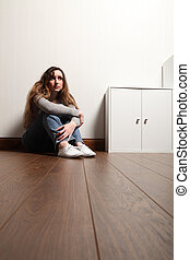 Teenage problems for young girl alone on the floor - Worried...