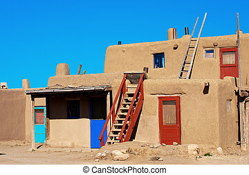 Taos Pueblo - Bright colorful doors of ancient Taos Pueblo,...