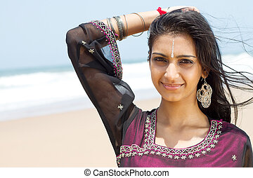 happy beautiful indian woman on beach