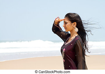 young indian woman at the beach