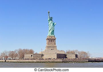 Statue of Liberty on Liberty Island closeup with blue sky in...