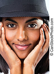 cute young indian girl face closeup with a hat
