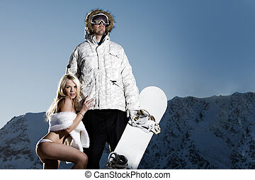 Snowboarder with groupie girl - Macho snowboarder with...