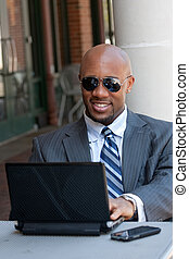 Business Man Working Wirelessly and Mobile - A handsome...