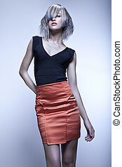 Fashion model with edgy haircut posing in studio - Blond...