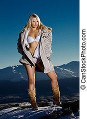 Outdoor lingerie - Lingerie model outside on snow covered...