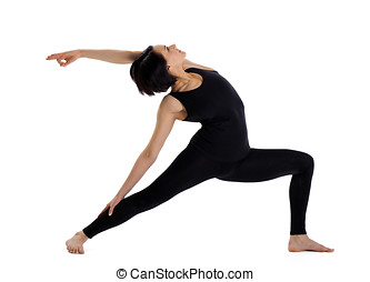 woman stand in yoga pose - warrior asana - young woman...