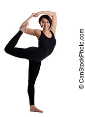 woman stand in yoga Dancer Pose - funky version - young...